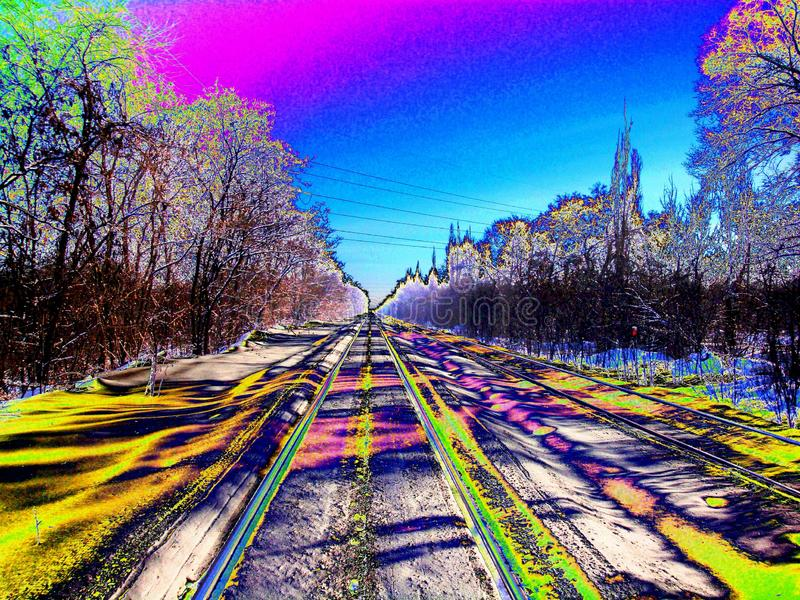 Railroad in motion at sunset. Railway station with motion neon royalty free stock photography