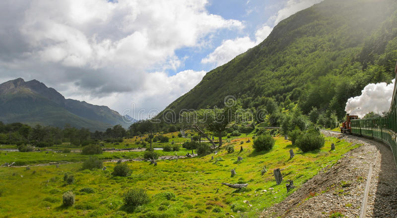 Railroad in National park. USHUAIA, ARGENTINA - FEBRUARY 2, 2006 : The Train of the End of the World passing through the Tierra del Fuego National Park in royalty free stock image