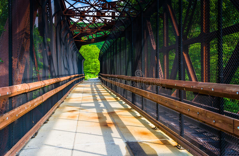 Railroad and pedestrian bridge at Lehigh Gorge State Park, Pennsylvania. stock photos