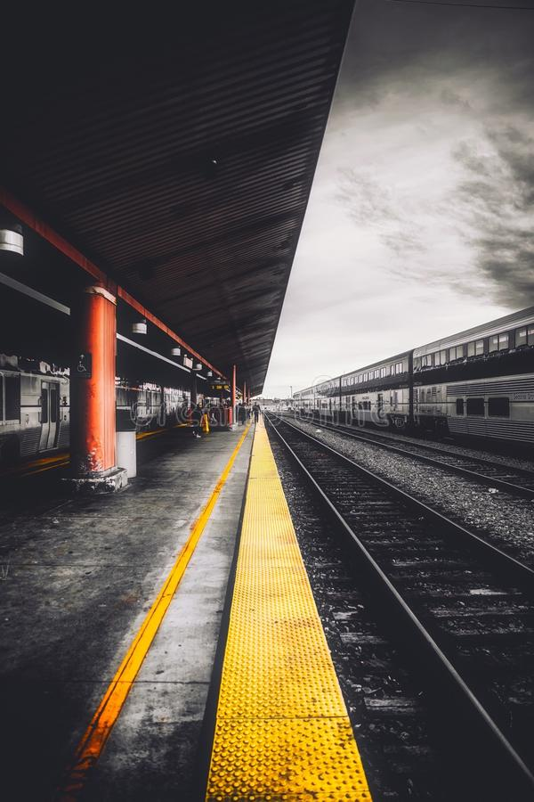 Railroad platform on station royalty free stock image
