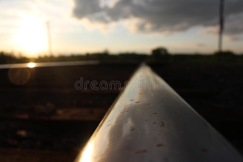 Railroad Rail. A photo showing a rail up close, as it disappears into the distance stock images