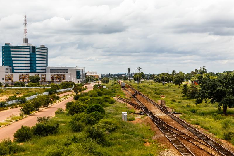 Railroad and rapidly developing central business district, Gaborone, Botswana, Africa, 2017. Botswanian, cbd, african, architecture, building, capital, center royalty free stock photography