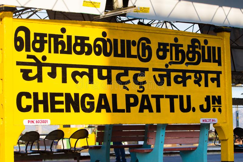 Railroad sign Chengalpattu written in Tamil official language of Tamilnadu , Hindi and English on platform of the stock photo