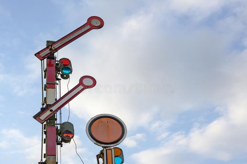 Railroad signal against the blue sky with clouds, copy space. Railroad signal red and white against the blue sky with clouds, copy space royalty free stock photography