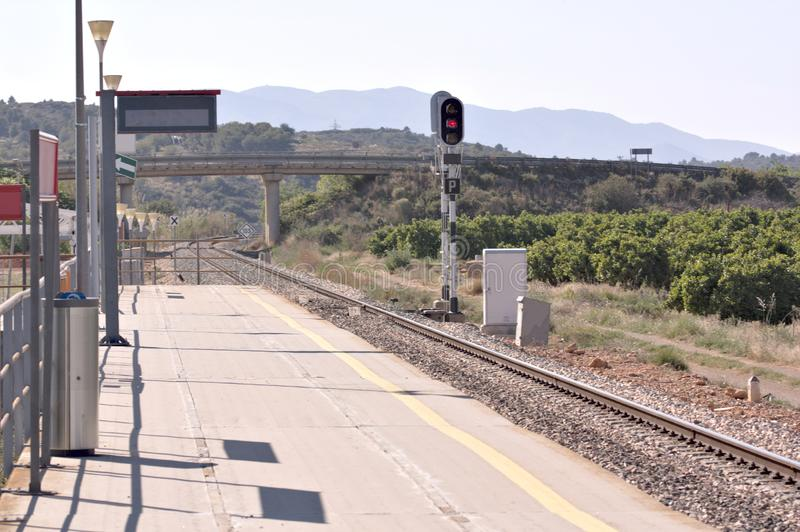 Railroad station in the middle of the field a sunny day. View of a station of the Spanish commuter railroad located in a rural area, line, town, industry, way stock photos