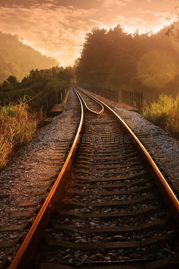 Railroad in sunset stock images