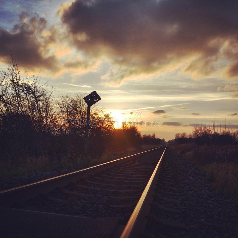 Railroad in the sunset stock image