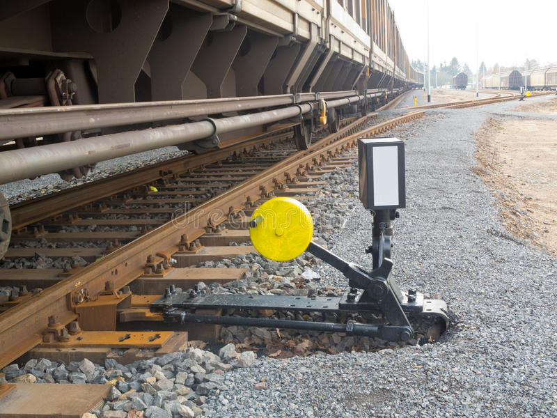 Railroad switch. Hand-operated railroad switch with lever, weight and signal stock photo