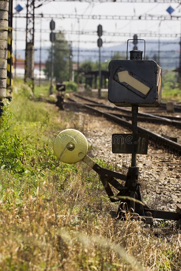 Railroad switch. With railroad and station in background royalty free stock images