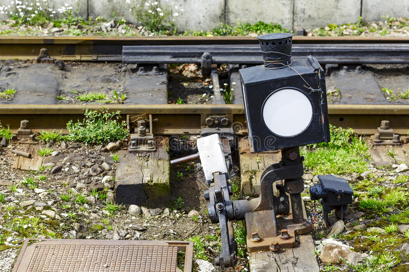 Railroad switch. Hand-operated railroad switch somewhere between the tracks royalty free stock photography