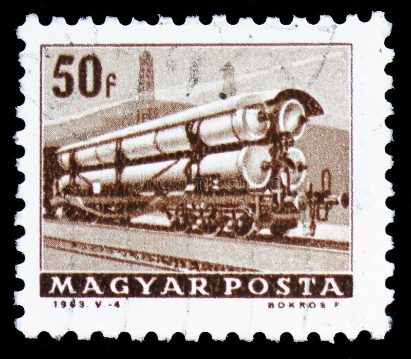 Railroad tank car, Transport and Telecommunication serie, circa 1963. MOSCOW, RUSSIA - MARCH 30, 2019: A stamp printed in Hungary shows Railroad tank car royalty free stock photography
