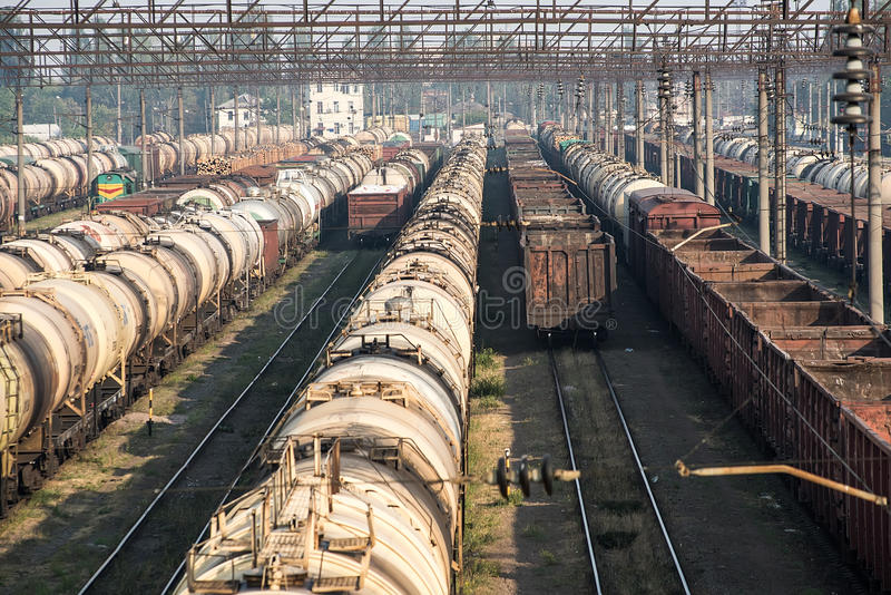 Railroad tank cars and cargo wagons. At the railway yard stock image