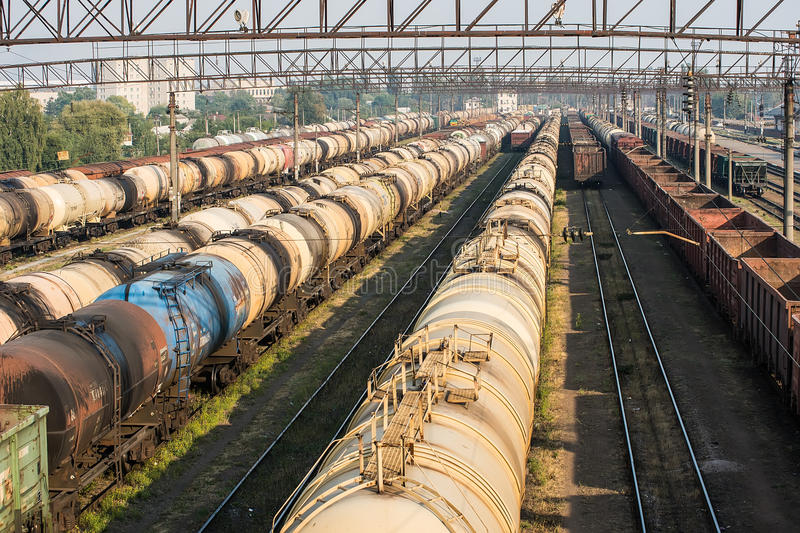 Railroad tank cars and cargo wagons. At the station in marshalling yard stock photos