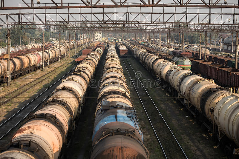Railroad tank cars and cargo wagons. At the station in marshalling yard stock image