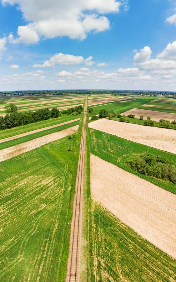 Railroad track amongst rural area aerial view stock photos