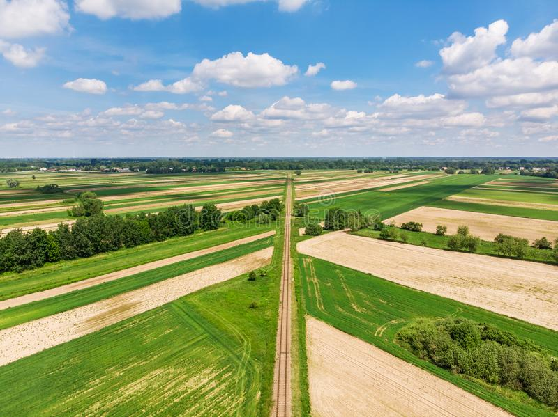 Railroad track amongst rural area aerial view stock photography