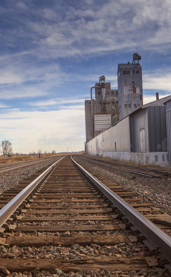 Railroad Track and Grain Elevator royalty free stock photo