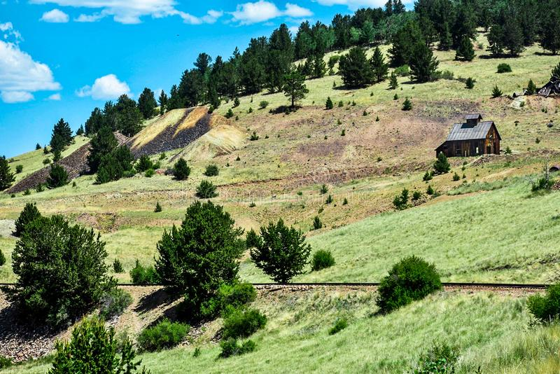 Railroad Track on a Mountain with an old Abandoned Building stock images