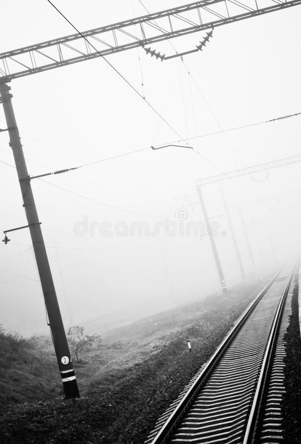 Railroad track. Railway rails in the fog royalty free stock photos