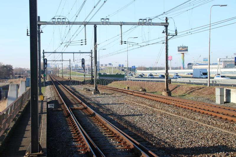Railroad track at train station Den Haag Ypenburg in The Hague in the Netherlands. Railroad track at train station Den Haag Ypenburg in The Hague in the stock photo