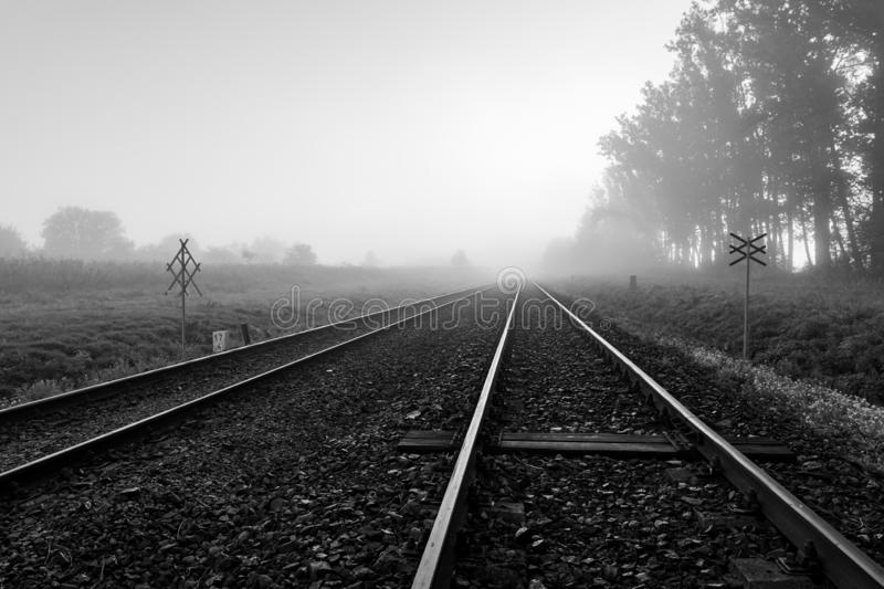 Railroad tracks in the fog. Foggy morning over a railway line in Central Europe stock photos
