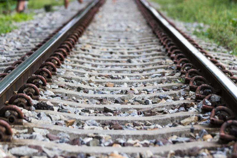 The railroad tracks are a long way straight ahead. Location Bangkok, Thailand royalty free stock photo
