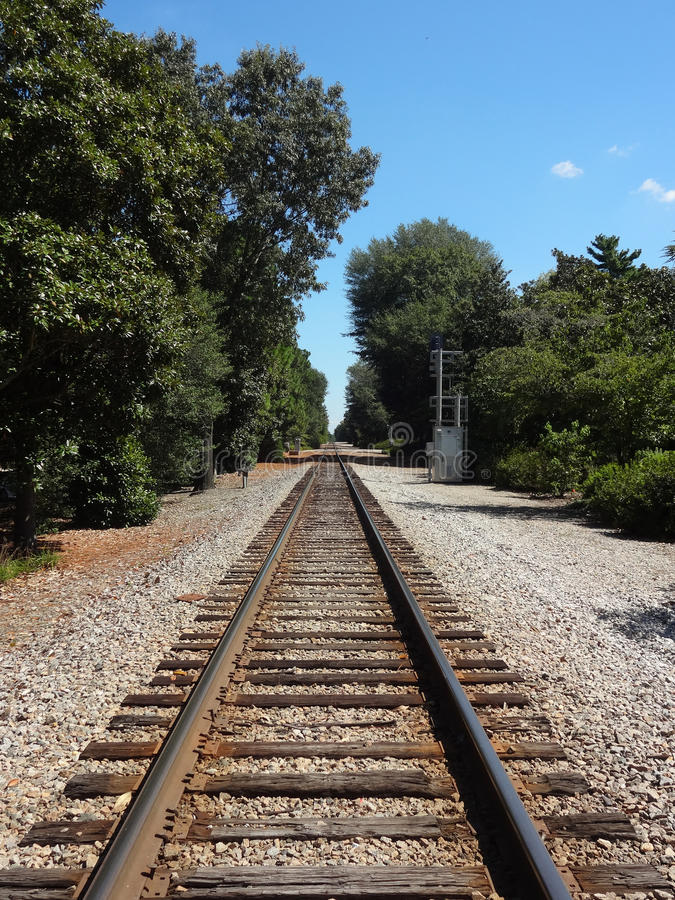 Railroad Tracks. Looking down railroad tracks on a clear day royalty free stock photos