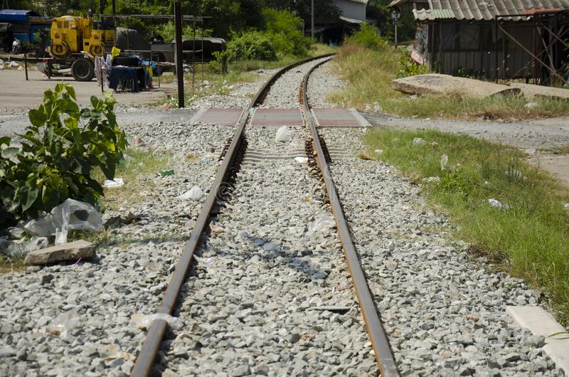 Railroad tracks and railway track tie sleeper for train running in Tha Chalom station at Mahachai in Samut Sakhon, Thailand stock images