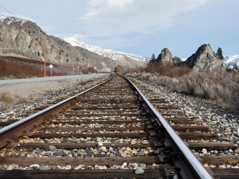 Railroad in Columbia river valley, WA. Railroad tracks running along the Columbia river valley north of Wenatchee, Eastern Washington state stock images