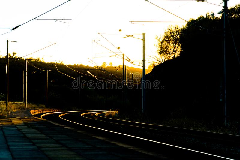 Railroad Tracks at Sunset royalty free stock image