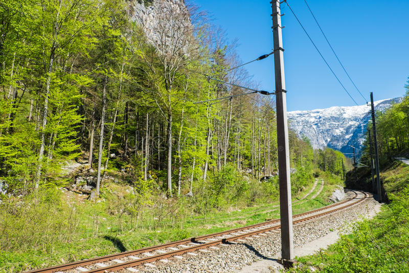 Railroad tracks to snow mountain royalty free stock images