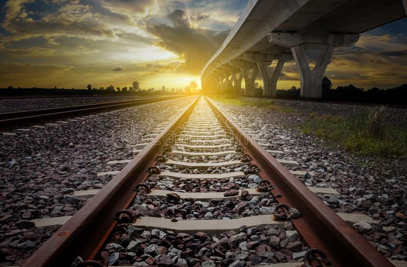 Railroad for transportation and elevated expressway with sunlig stock photography