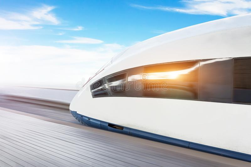 Railroad travel passenger train high speed with motion blur effect, against the blue sky.  royalty free stock image