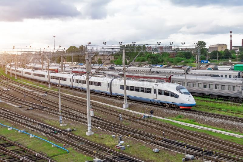 Railroad travel passenger train, industrial a district of the city.  stock photo