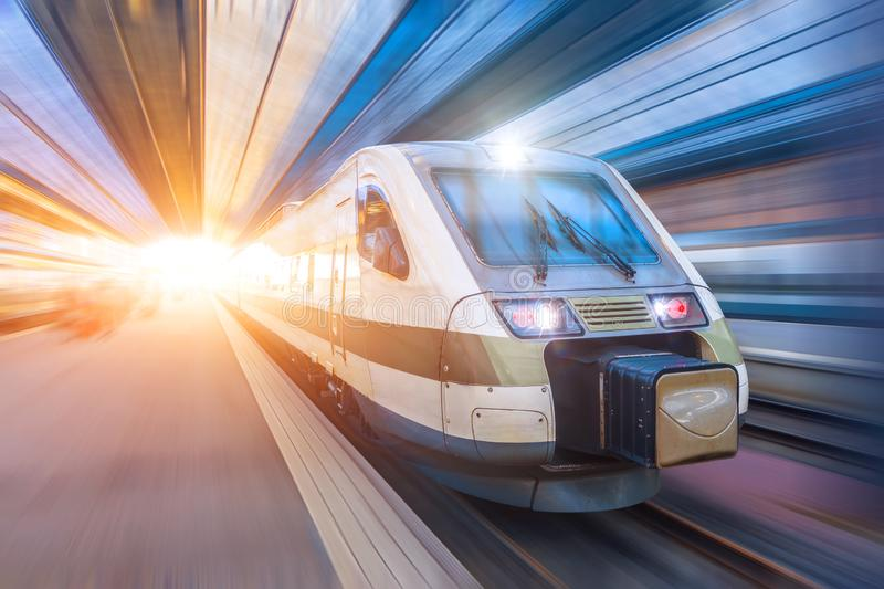 Railroad travel passenger train with motion blur effect, industrial a district of the city stock image