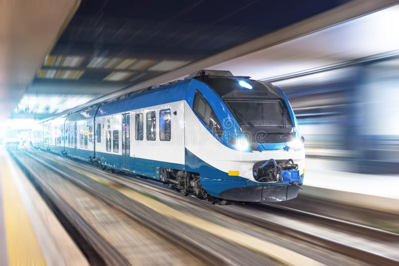 Railroad travel passenger train with motion blur effect night, industrial concept, tourism stock photography