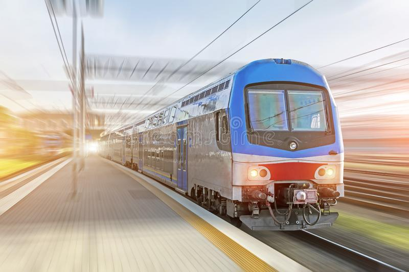 Railroad travel passenger train with motion blur effect at the railway station, industrial concept, tourism royalty free stock photos