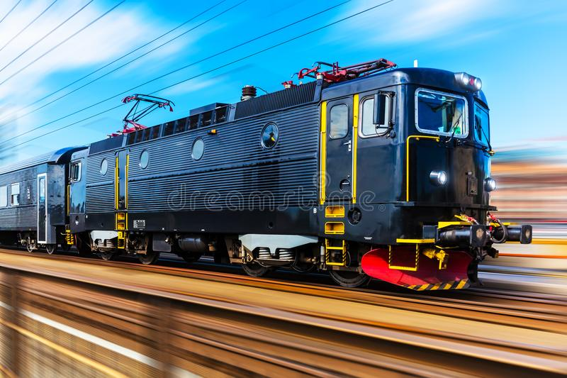 Modern high speed passenger train. Railroad travel and railway tourism transportation industrial concept: scenic summer view of modern high speed passenger royalty free stock photo