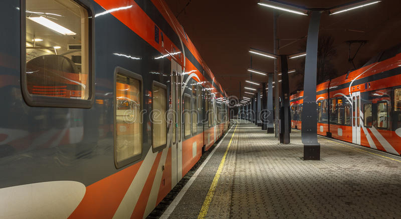 Railroad travel and transportation industry business concept: summer night view of two high speed modern passenger royalty free stock photo