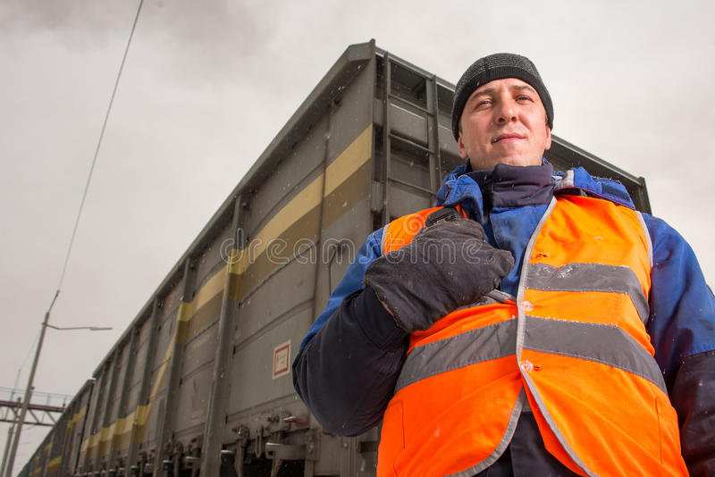 Railroad worker with wagon on the background stock photography
