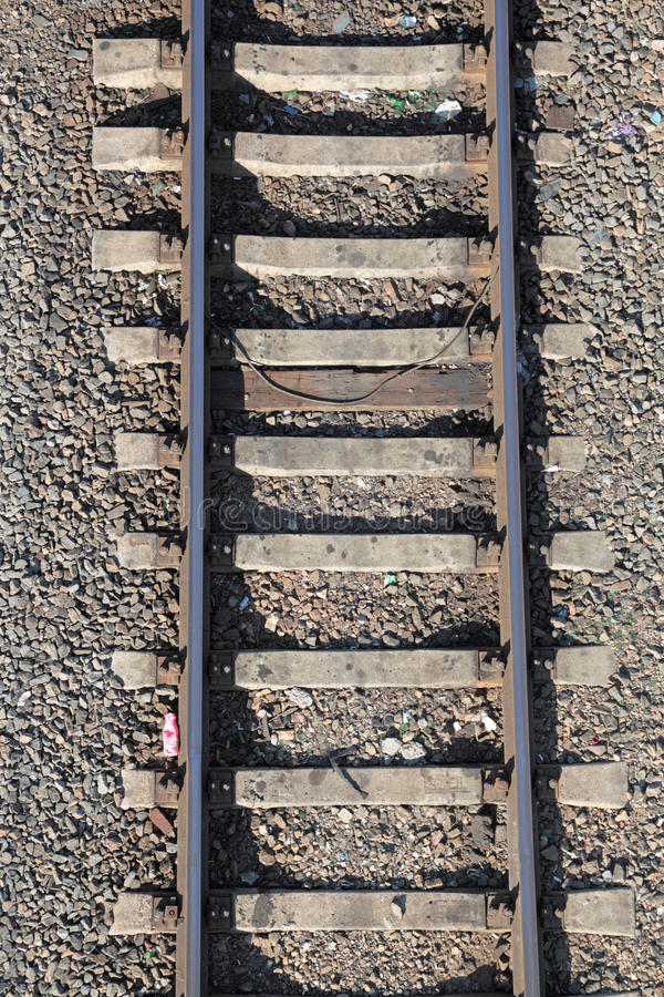 Rails. Railway rails on concrete cross ties, a close up, the top view stock photography