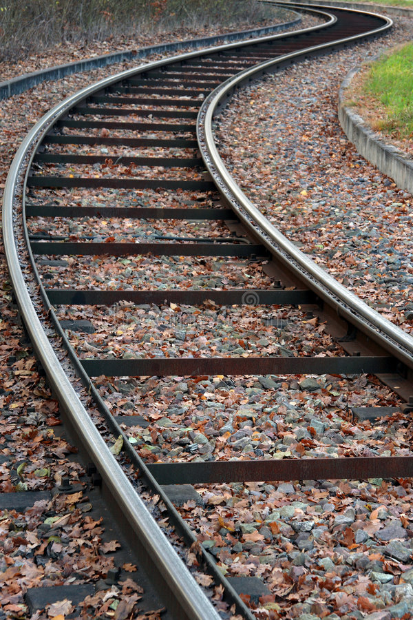Rails. Perspective of curved rails in autumn stock images