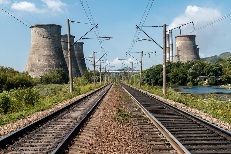 Rails along coolers. Railway rails along coolers of thermal power plant royalty free stock images