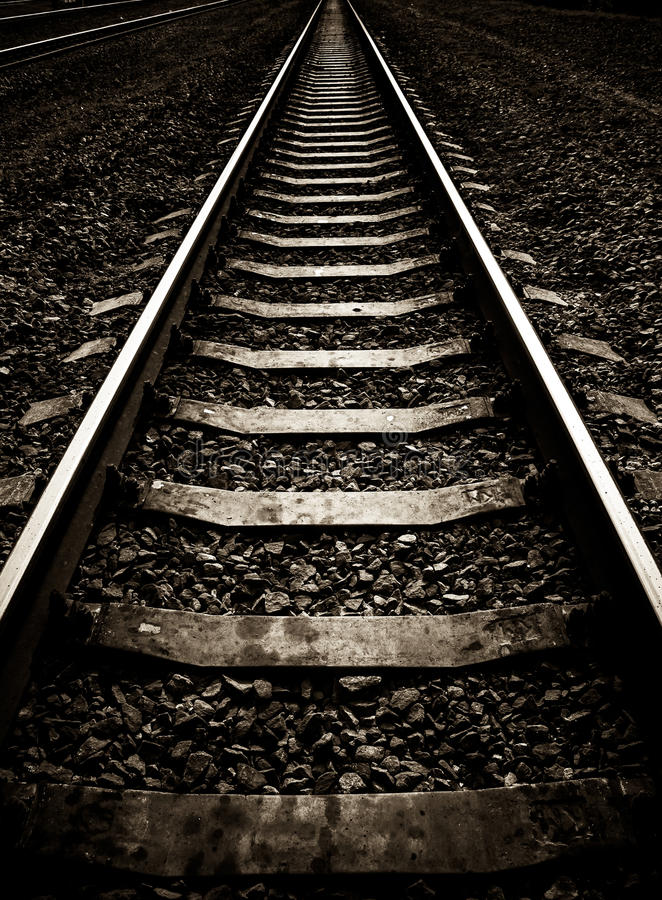 Rails and concrete sleepers. Depressive composition stock image