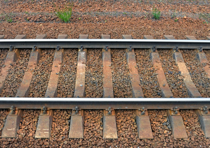 Rails and cross ties. Fragment of railway track. Rails and cross ties. Top view from side. Background stock photo