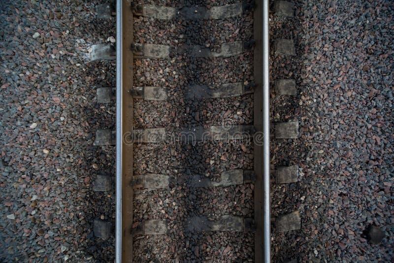 Rails and cross ties of railway among stones royalty free stock photography