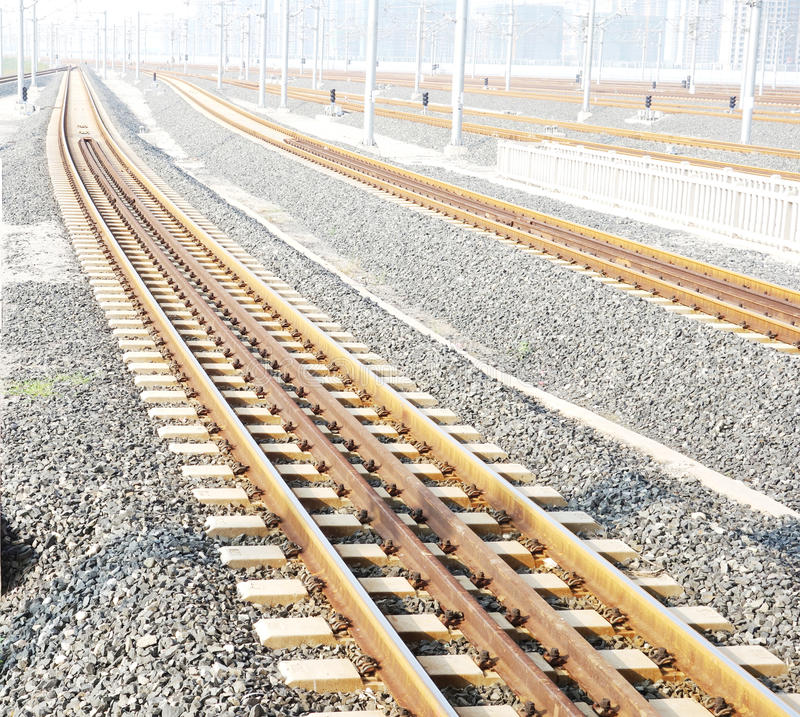 Rails disappear into far places. Rails from railway station disappear into far places stock photography