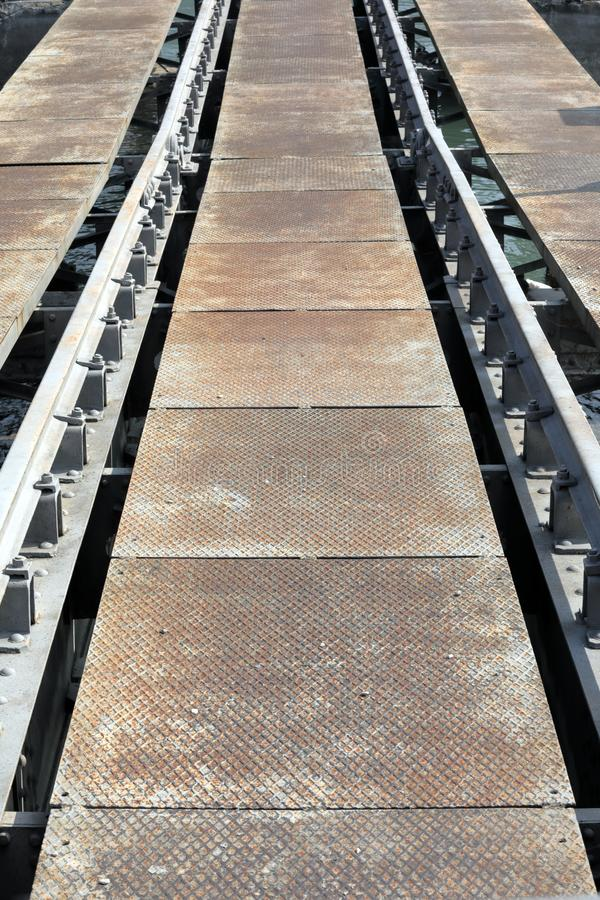 Rails on the dock for dry recovery of boats. For repairs stock photos