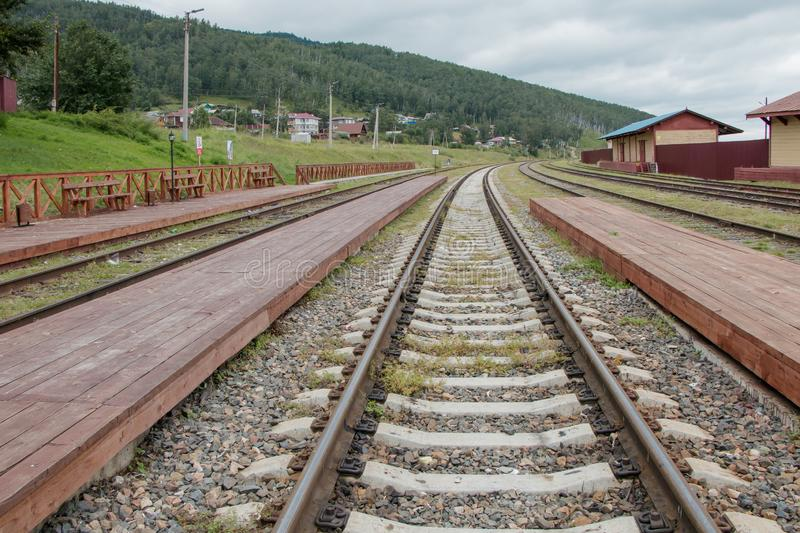 Rails extending into the distance. Close-up. Kultuk station of the old part of the Circum-Baikal Railway, Russia royalty free stock photo