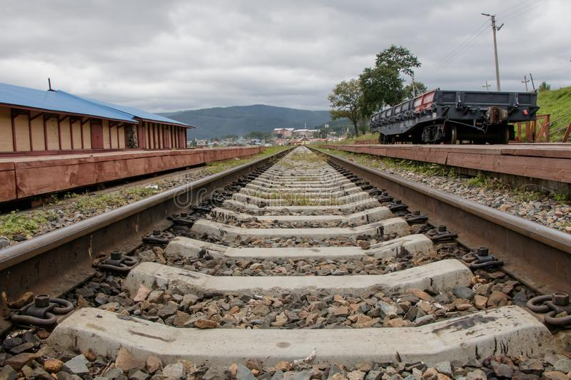 Rails extending into the distance. Close-up. Kultuk station of the old part of the Circum-Baikal Railway, Russia stock photos